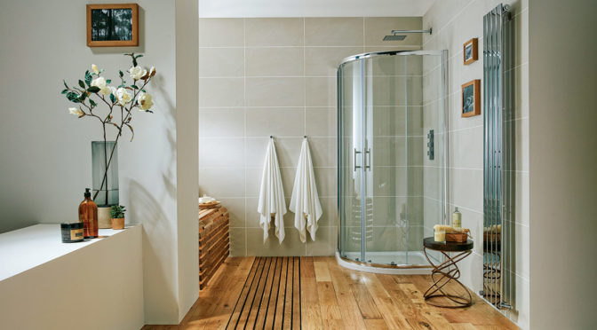 a quadrant shower enclosure in bathroom with wooden floor