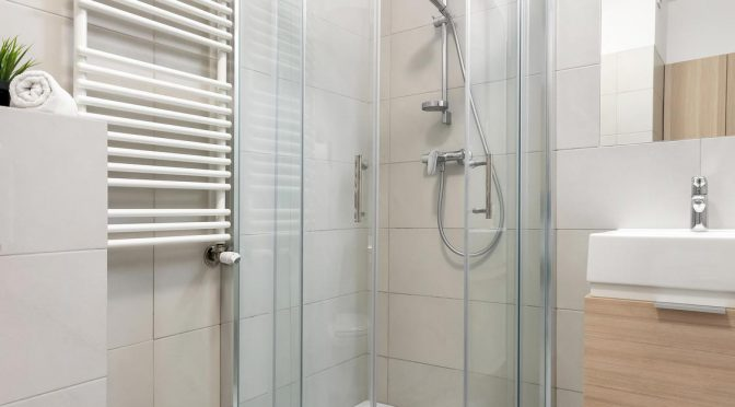 Compact shower cubicle in the corner of the bathroom