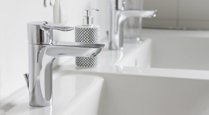 Chrome mixer taps on a twin sink vanity unit