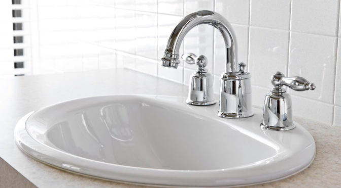 3 tap hole sink with spout and levers