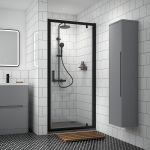 Nuie Pacific Black Profile Pivot Shower Door shown in a recess