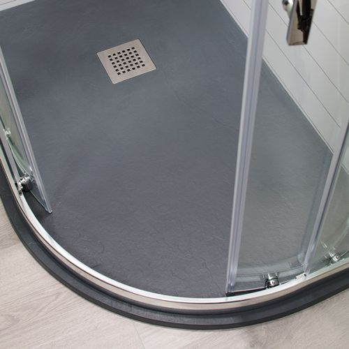 Grey slate offset quadrant shower tray with a matching shower enclosure