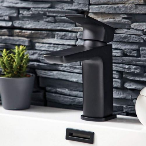 Shield mono black basin mixer tap with stone wall background