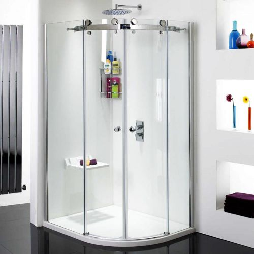 Phoenix fold up shower seat being used in a quadrant shower enclosure
