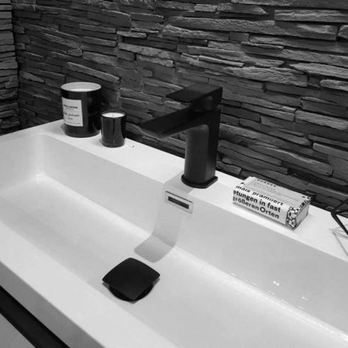 Scudo mono black tap mounted on a vanity unit