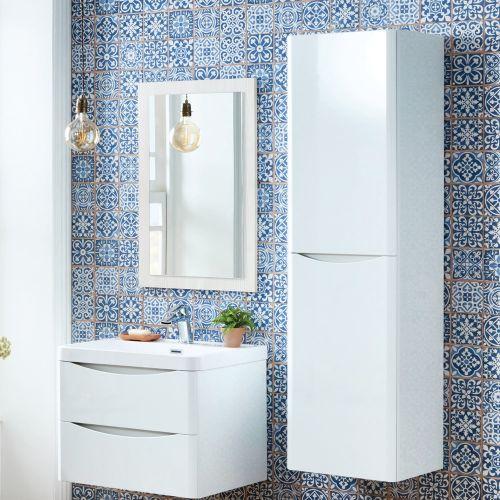 White scudo mirror  next to freestanding furniture