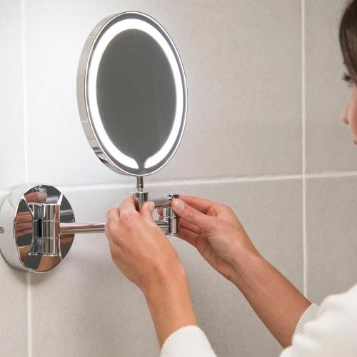 Scudo make-up mirror being pulled away from the wall